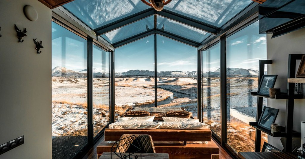 A prefab glass cabin with a very Icelandic view