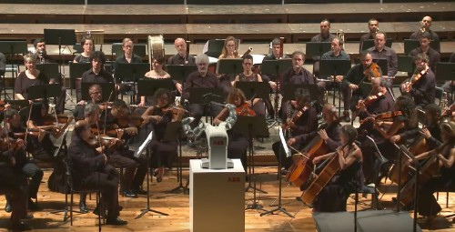 YuMi the robot makes debut as orchestra conductor in Italy