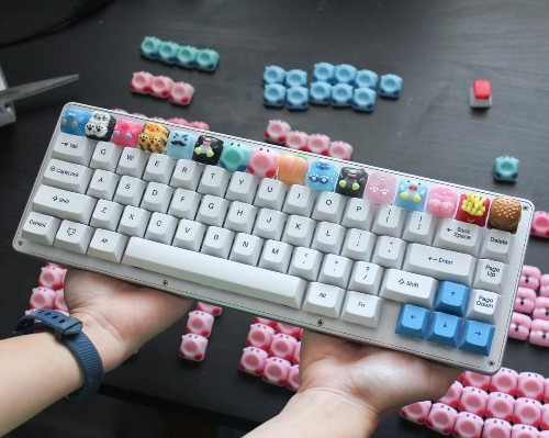 The artist putting tiny Kirby, waffles, and SpongeBob on your mechanical keyboard