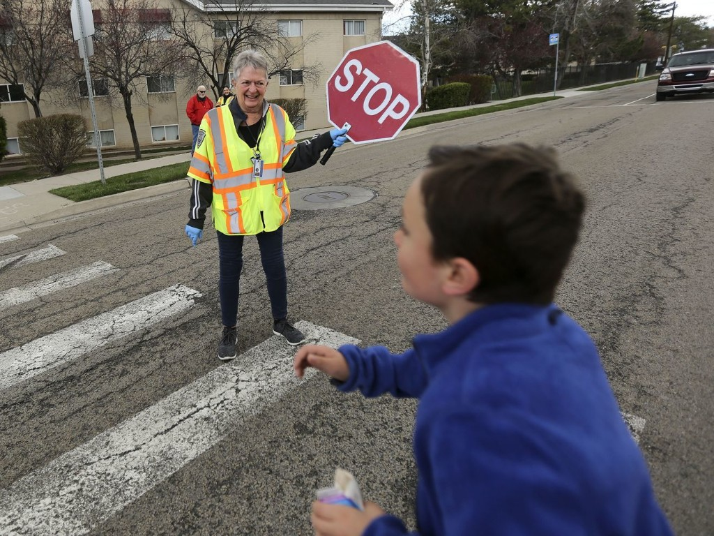 Crossing guards continue services amid pandemic, helping students access meals