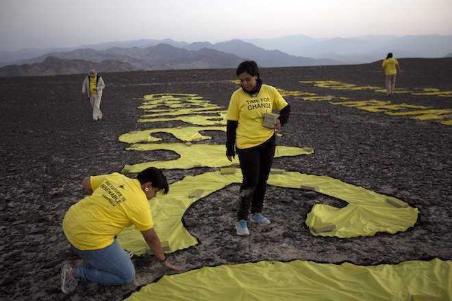 Greenpeace activists damage Peruvian heritage site to send environmental message