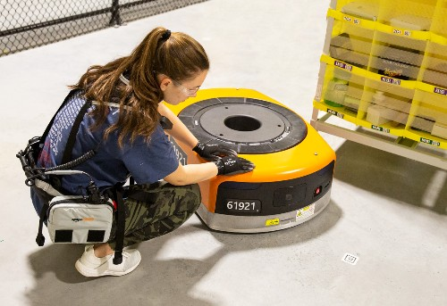 Amazon warehouse workers are getting utility belts to ward off robots