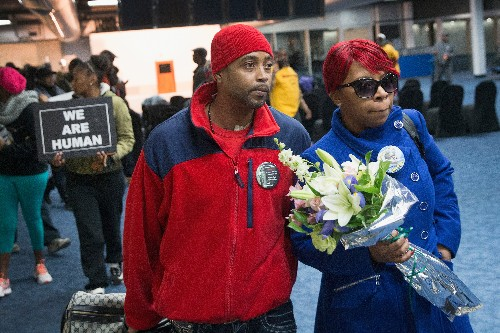 Michael Brown's family: 'ensure that every police officer working the streets in this country wears a body camera'
