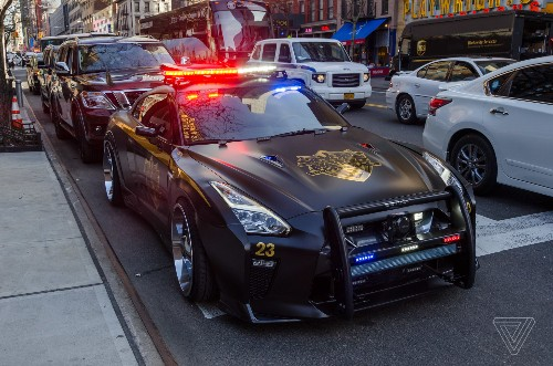 This Nissan GT-R looks like the evil cop car from Transformers