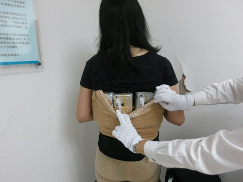 iPhone smuggler caught with 102 phones strapped to her body