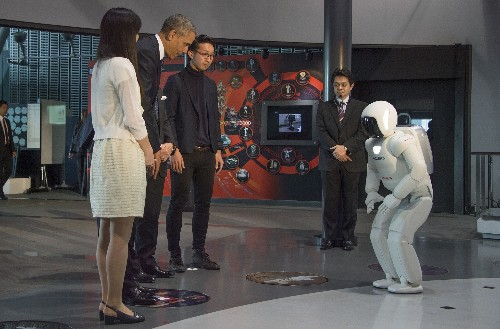 President Obama plays soccer with a Japanese robot