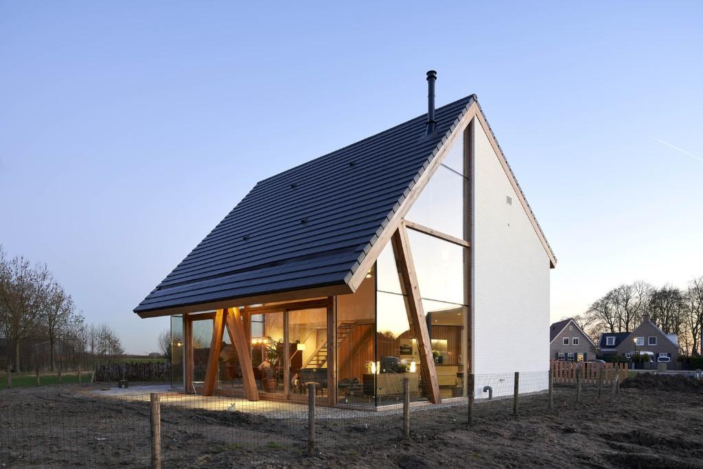 Modern barn is half transparent, half concealed