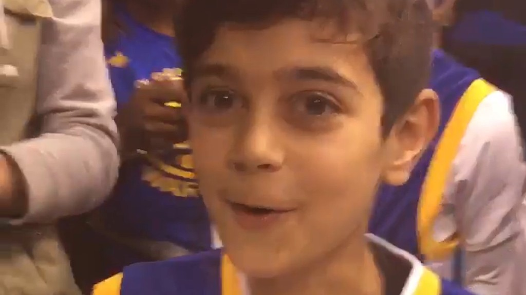 Curry makes a fan's birthday with game-worn shoes