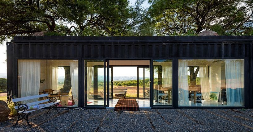 Glass-walled shipping container makes scenic shelter in Argentina
