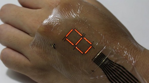 Super-thin electronic skin lights up a digital display on your hand