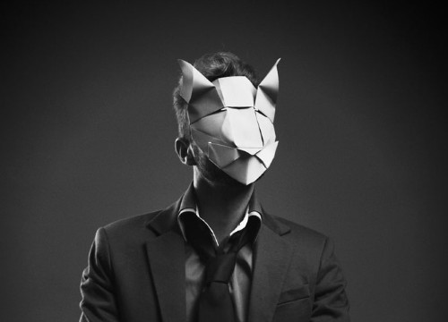 Origami turns creepy in artist's paper mask portraits