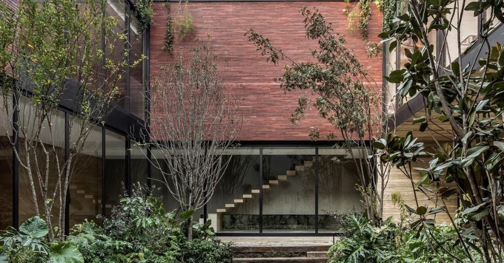 Modern brick home surrounds a lush courtyard