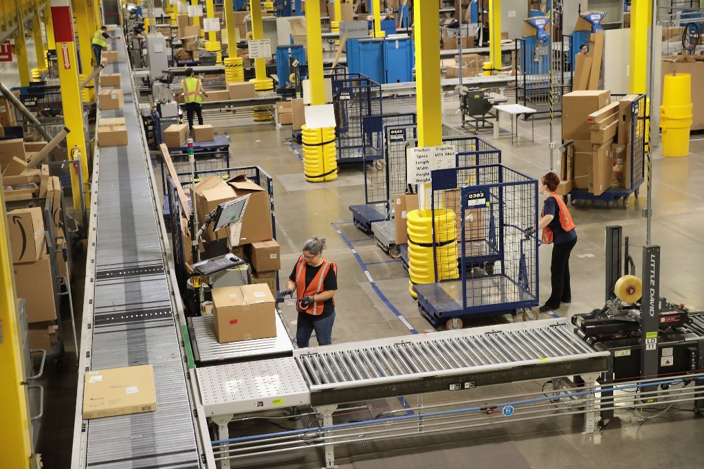 Amazon eliminates monthly bonuses and stock grants after minimum wage increase