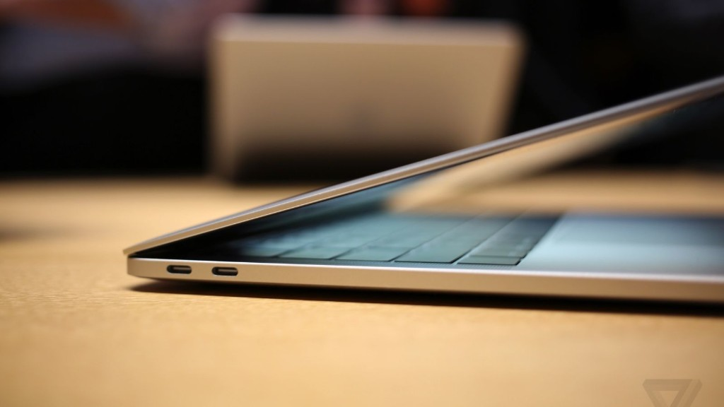 You need an adapter (or a new cable) to plug your iPhone into the new MacBook Pros
