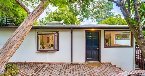 Laurel Canyon house is surrounded by trees for $999K