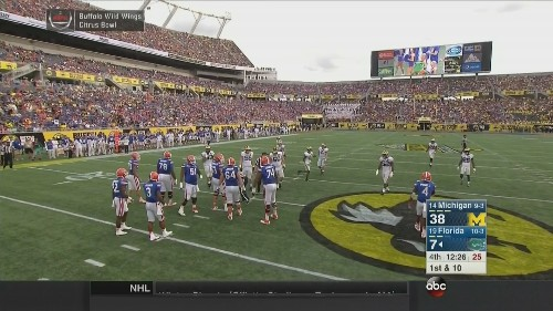 Can you spot the hidden Buffalo Wild Wings ads at the Citrus Bowl?