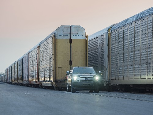 Ford teases all-electric F-150 pickup truck by pulling a million-pound train