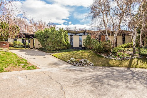 Midcentury showstopper with floating accordion roof asks $649K