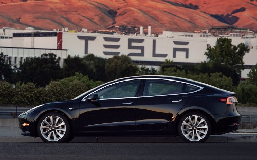 Elon Musk shows off first production Tesla Model 3