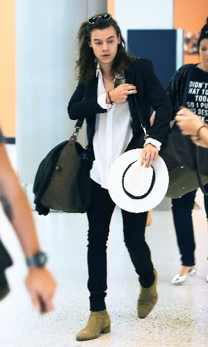 Harry Styles Accessorizes Bright White Hat With Airport