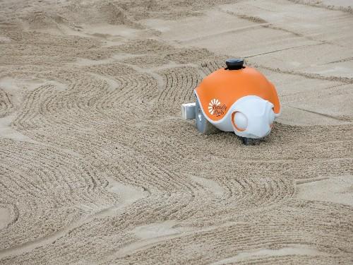 This autonomous robot draws sand art and looks like a turtle