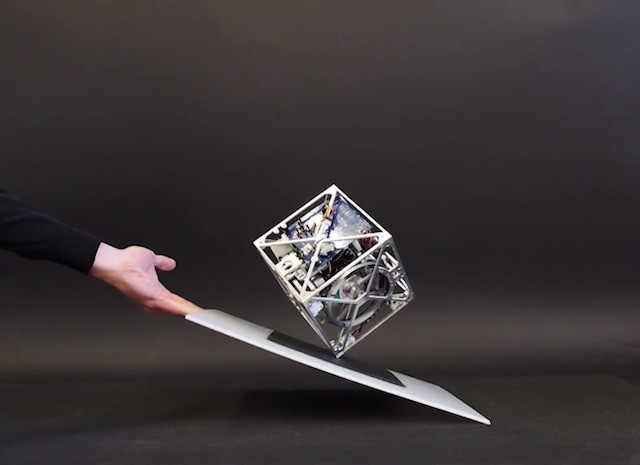 Watch a robotic cube walk and balance under its own power