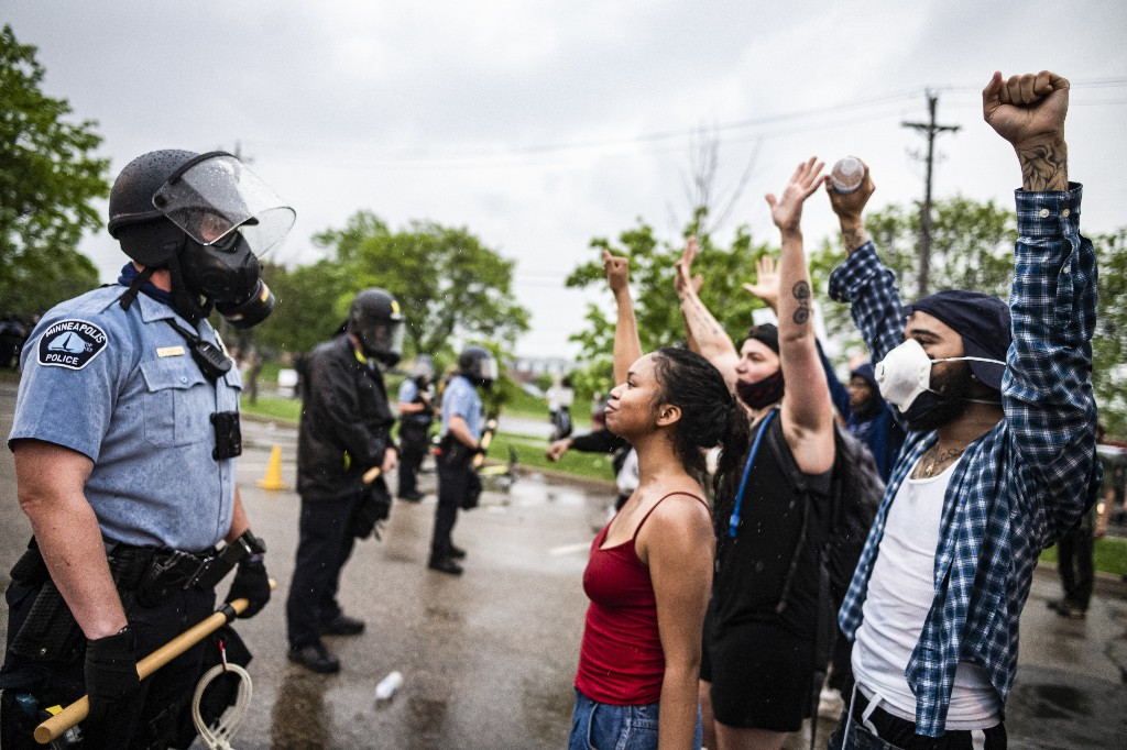 These photos capture the stark contrast in police response to the George Floyd protests and the anti-lockdown protests
