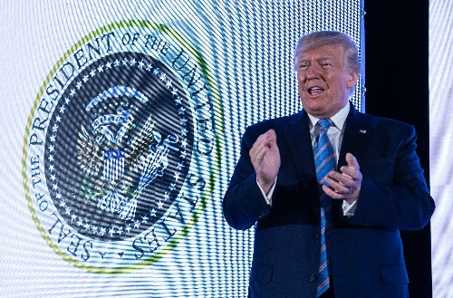 """45 is a puppet"": Trump spoke in front of an altered presidential seal and nobody knew"
