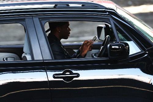 Smart security cameras will be able to tell if you're texting and driving