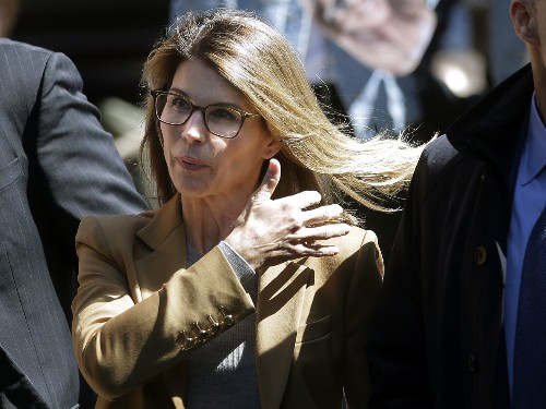 A parent was sentenced in the college admissions case. The sentence may mean something for Lori Loughlin