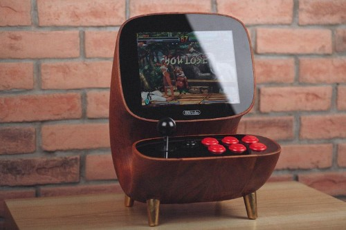 Having this retro arcade console on your desk will make you the coolest person in the office