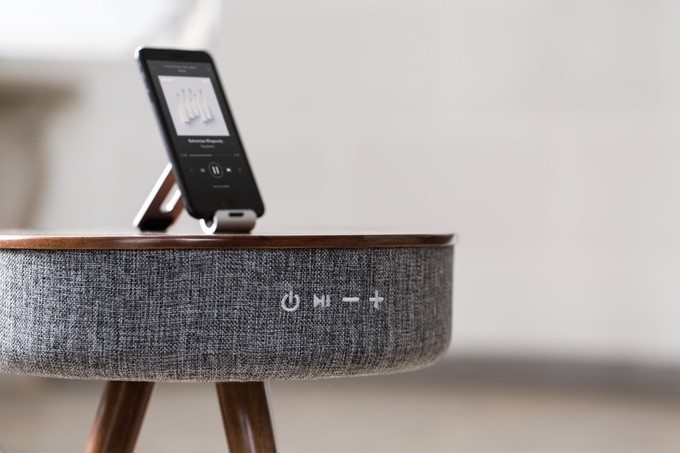 Kill three birds with one stone with this Bluetooth speaker power bank table
