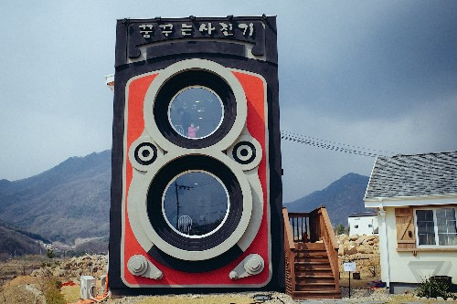 Drinking coffee inside a two-story camera