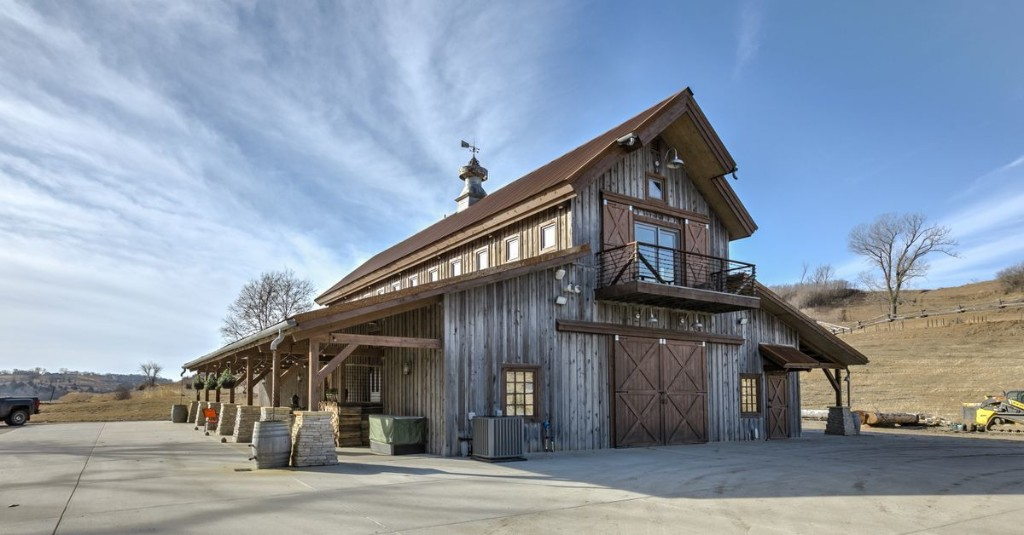 A barn house asking $1.2M has horse stalls for bedrooms