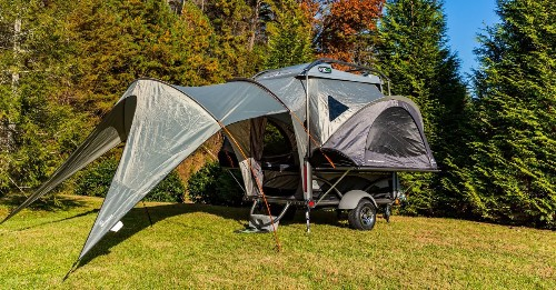 Versatile travel trailer camps four and hauls gear for $10K