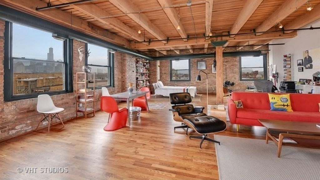 Live wall-free in this $329K West Town timber loft