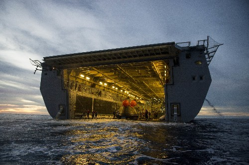The Navy retrieved Orion from the ocean and is bringing it home to NASA