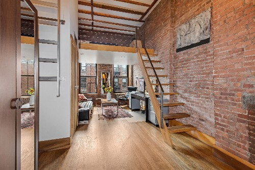 For $460K, an industrial-chic East Village studio with a sleeping loft