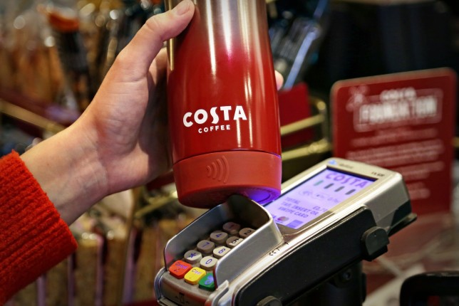 This coffee cup can be topped up with cash to pay for your drink