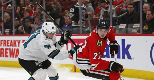 Blackhawks use late surge to rout Sharks 6-2