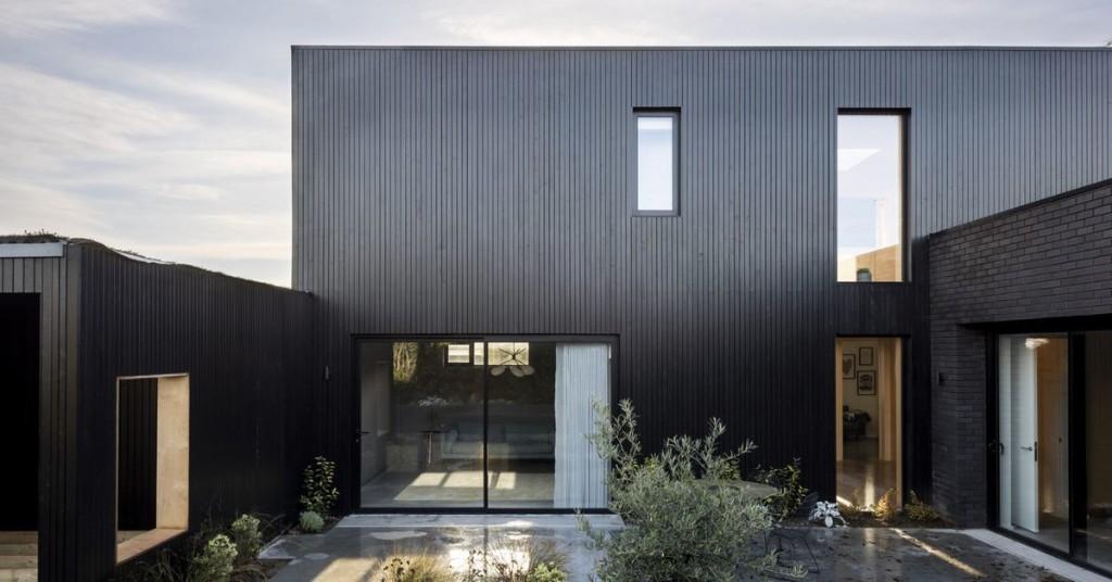 All-black modern house conceals crisp, clean interior