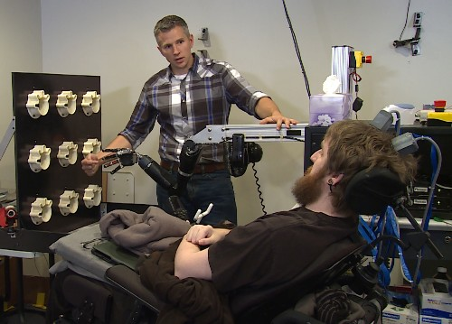 Brain chips let a paralyzed man feel touch through a robotic arm