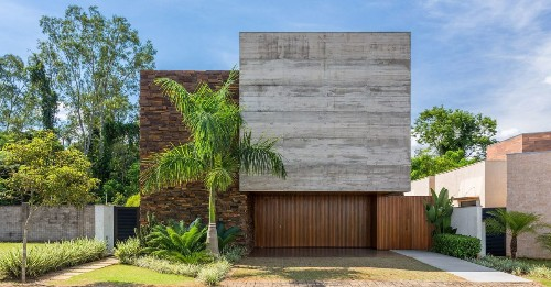 Modern home's facade is built from a beautiful trio of materials