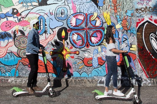 Uber is teaming up with Lime to add electric scooters to its app