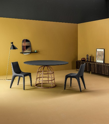 Alain Gilles designed this cheeky table with a birdcage base for Bonaldo