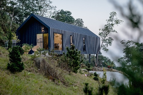 Simple house on stilts makes a budget-conscious mountain retreat