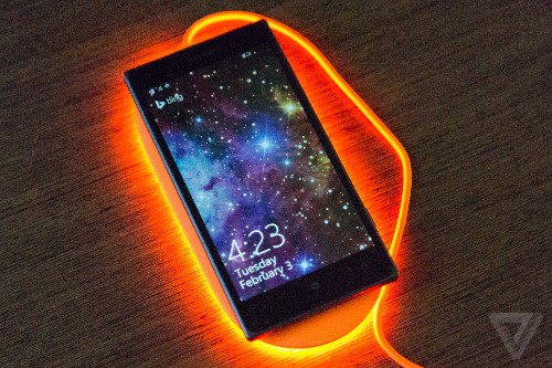 Microsoft's new wireless phone charger will bathe your desk in neon light
