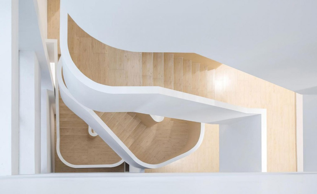 Shanghai building transformed into flowing office with sculptural staircase by ArchUnits
