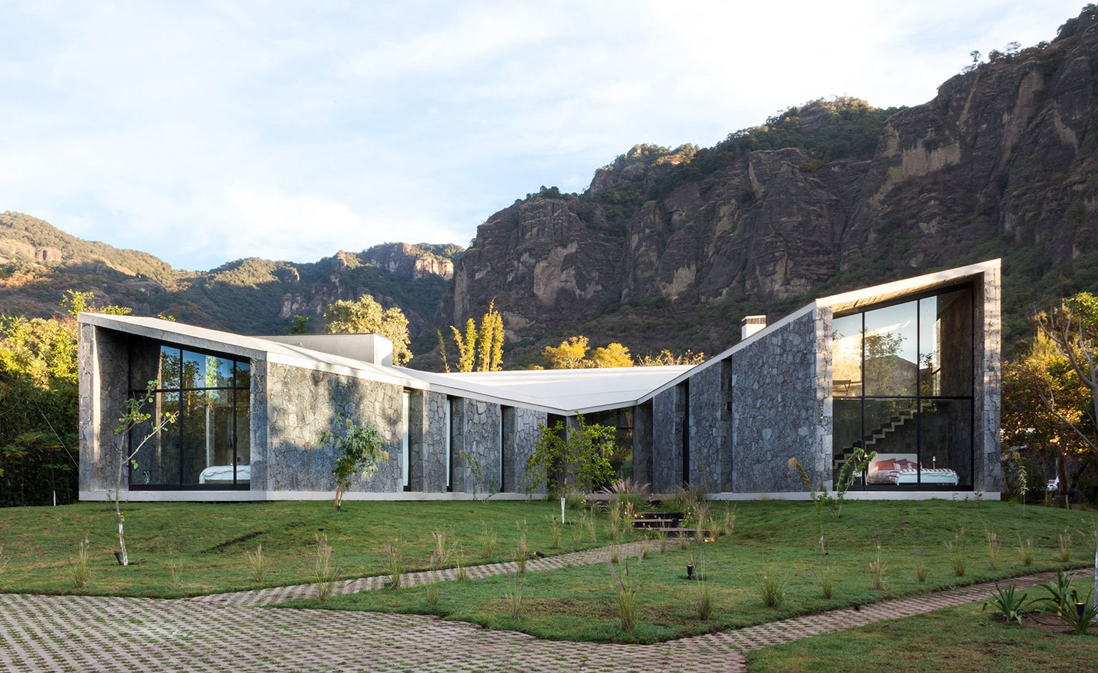 A volcanic stone house by Cadaval & Solà-Morales holds its own in Mexico