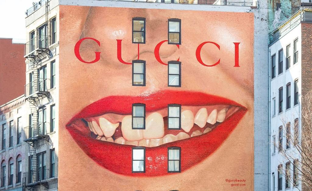 Gucci plants Martin Parr's lip print on walls around the world